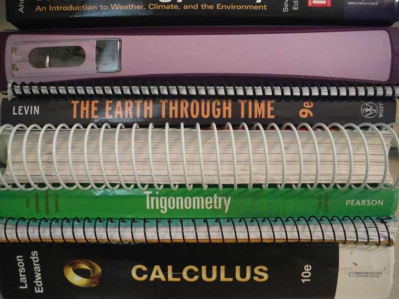 Textbook stack: Photo copyright Sara J. Bruegel, 2014