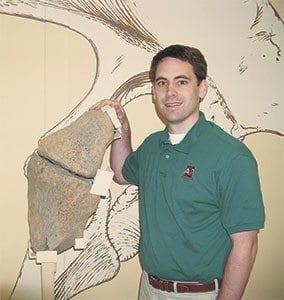 apologetics.org Eric with Apatasaurus Hip Bone
