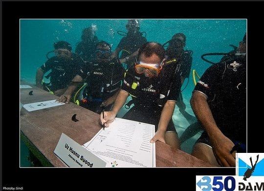 Photo of Maldives signing document underwater