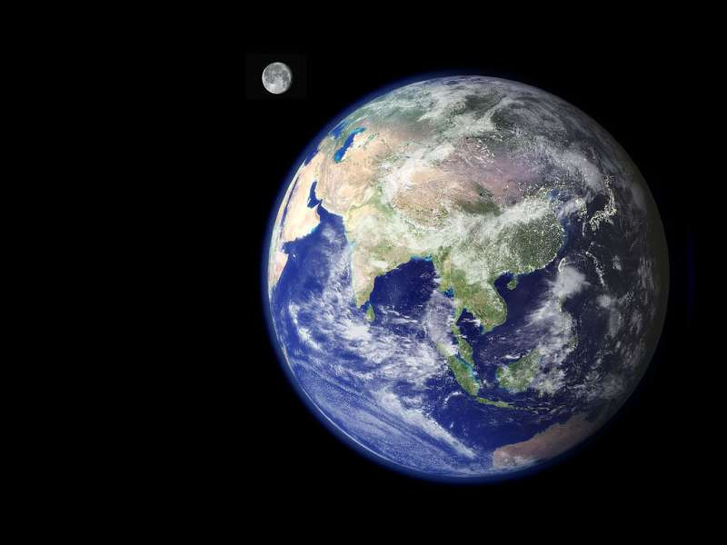 Earth showing Asia from space with the moon to the side. Photo credit: NASA