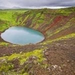 Volcanic crater covered in greenery with lake