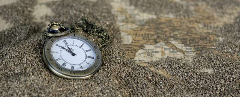 Pocket Watch lying on a granite surface, photo credit Pixabay