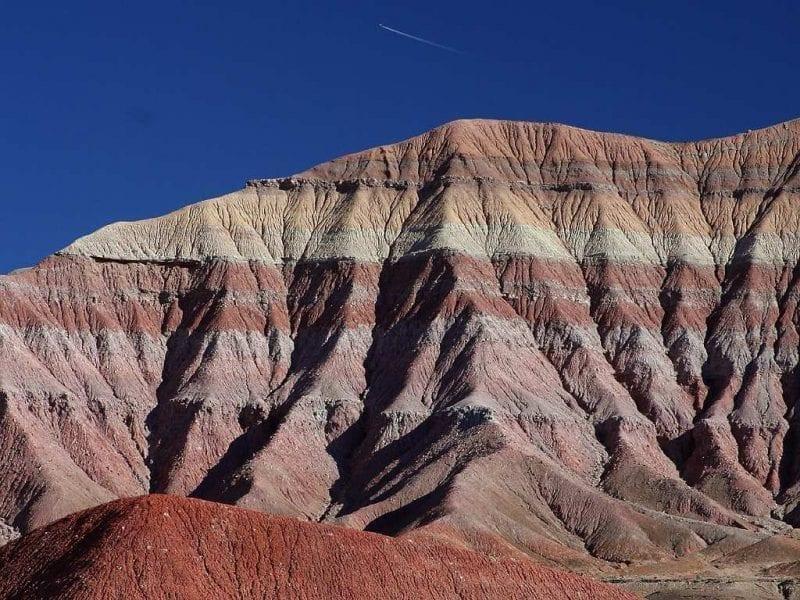 Flat sedimentary layers showing through bare eroding hillside