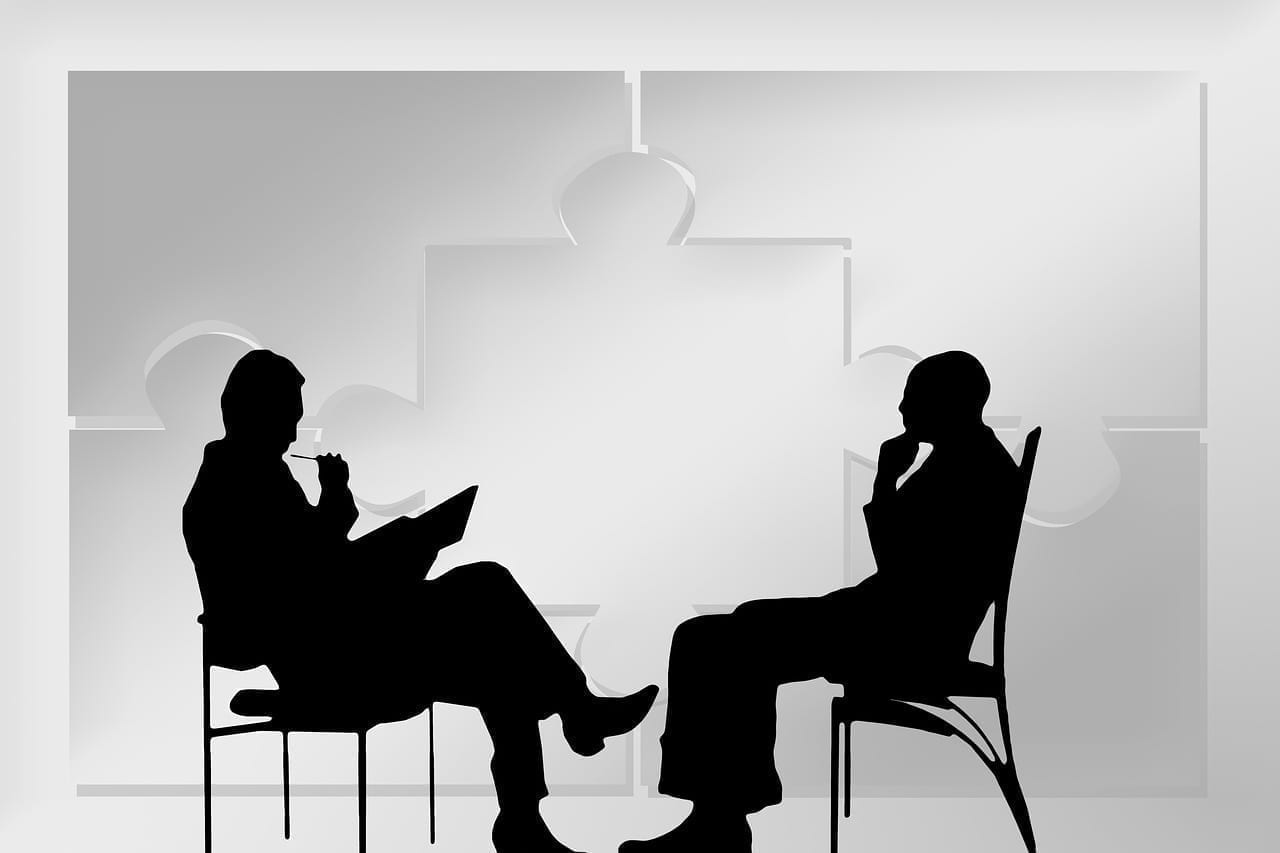 Silhouette two men discussing: photo credit: Pixabay