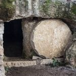 Rock-cut tomb with round stone rolled back