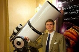 David Rives with large white telescope