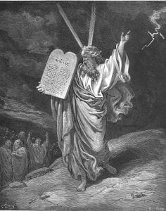 Etching of Moses holding the 10 commandments