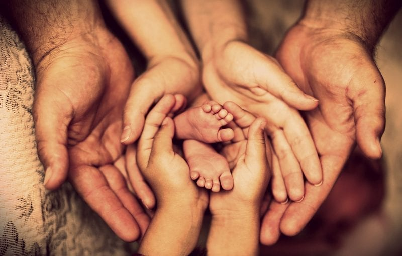 Family hands with baby's feet: ID 67913634 © Stanislav Petriaikin | Dreamstime.com