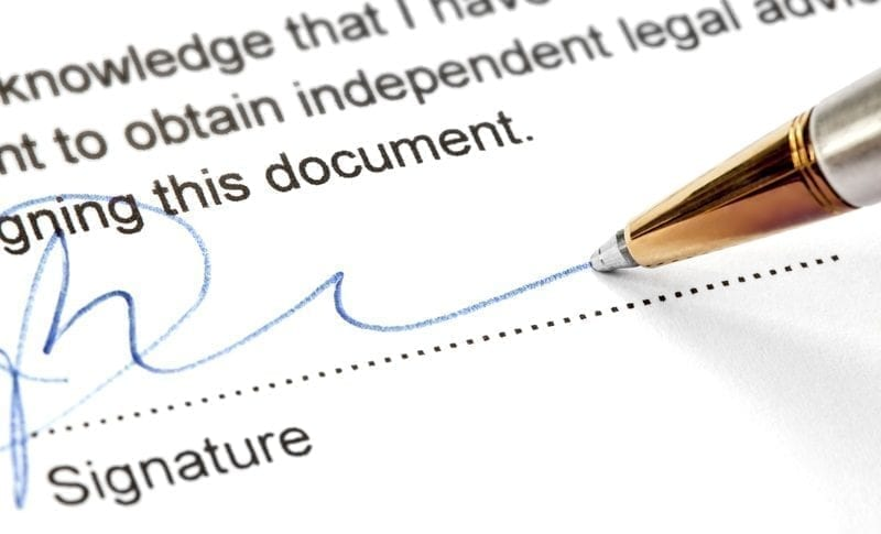 Signing a legal document, photo credit: ID 49192978 © Robyn Mackenzie | Dreamstime.com