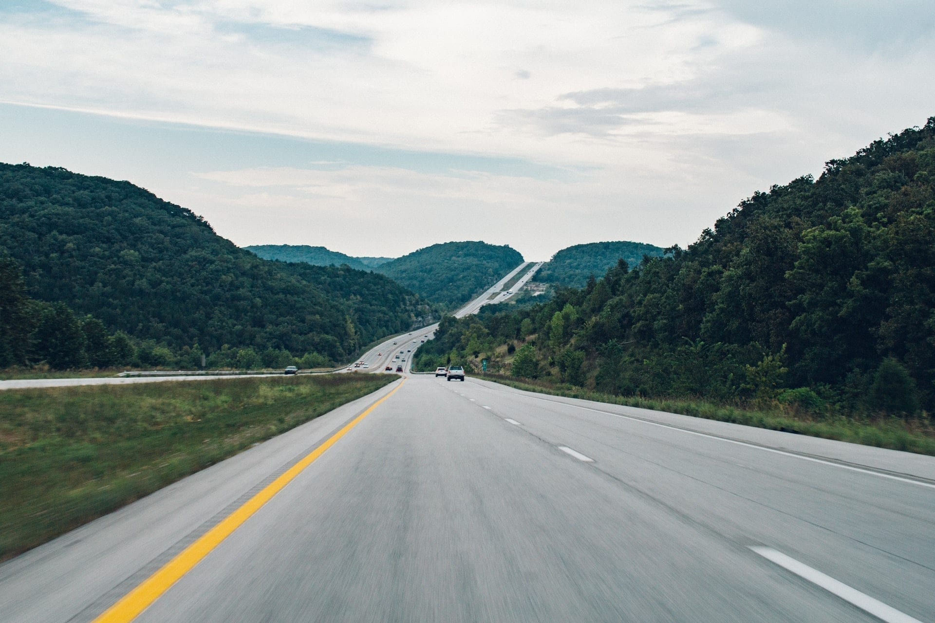 Freeway through forested hills, photo credit: Josh Sorenson