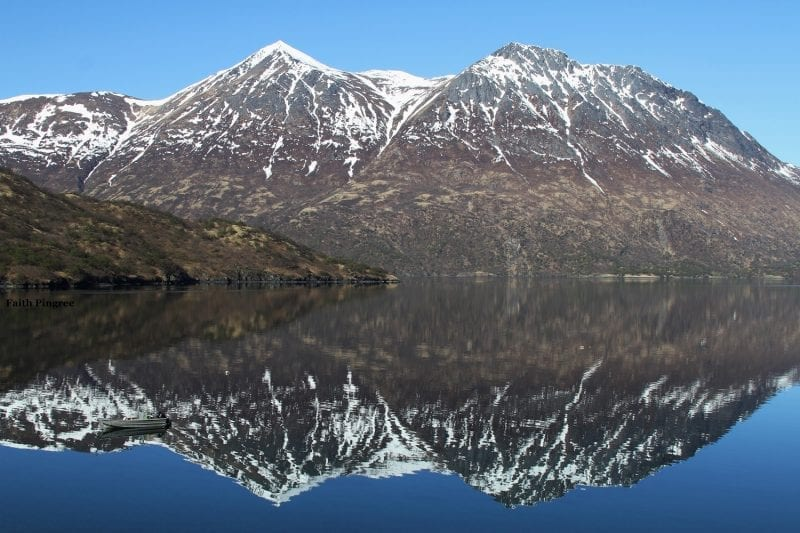Snow dusted mountains reflecting on water, photo credit, Faith P