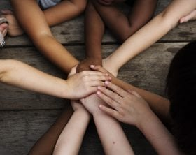 Different hues of children's hands and arms joining together: ID 96004707 © Rawpixelimages | Dreamstime.com