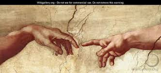 close up of Michelangelo's creation of man painting (hands touching)