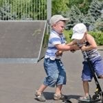 Two boys fighting over a scooter: ID 32261797 © Ampack   Dreamstime.com