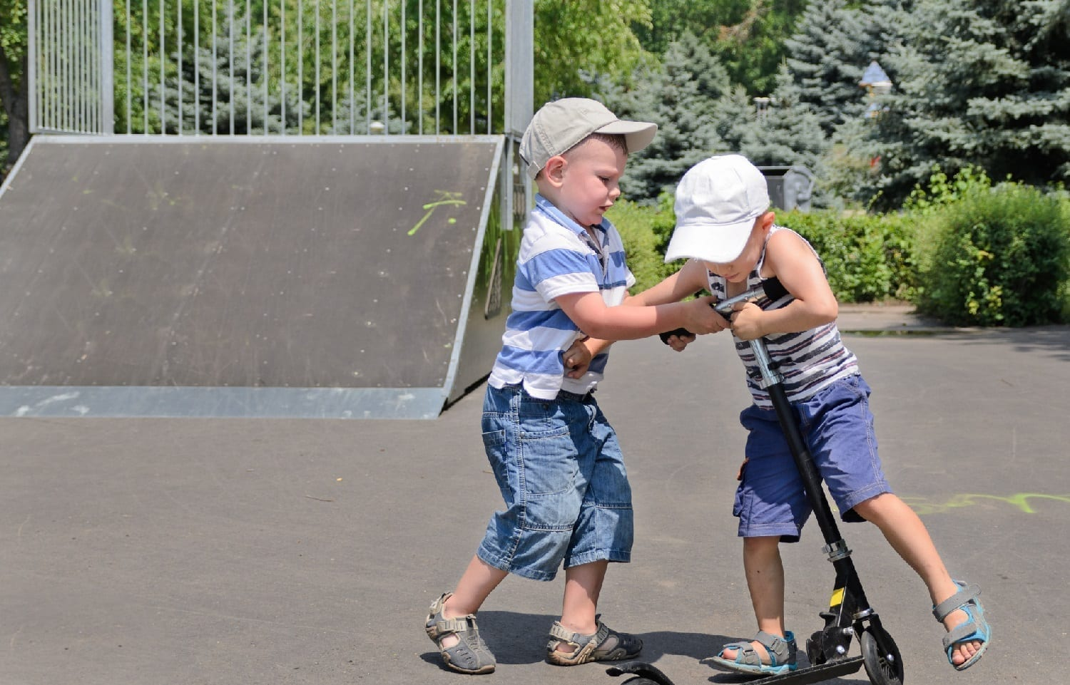 Two boys fighting over a scooter: ID 32261797 © Ampack | Dreamstime.com