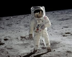 Buzz Aldrin on his moon walk with Armstrong reflected in his visor, photo credit: NASA