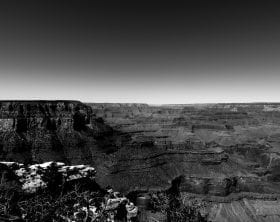 Black and white panorama of the Grand Canyon emphasizing the flat horizon above