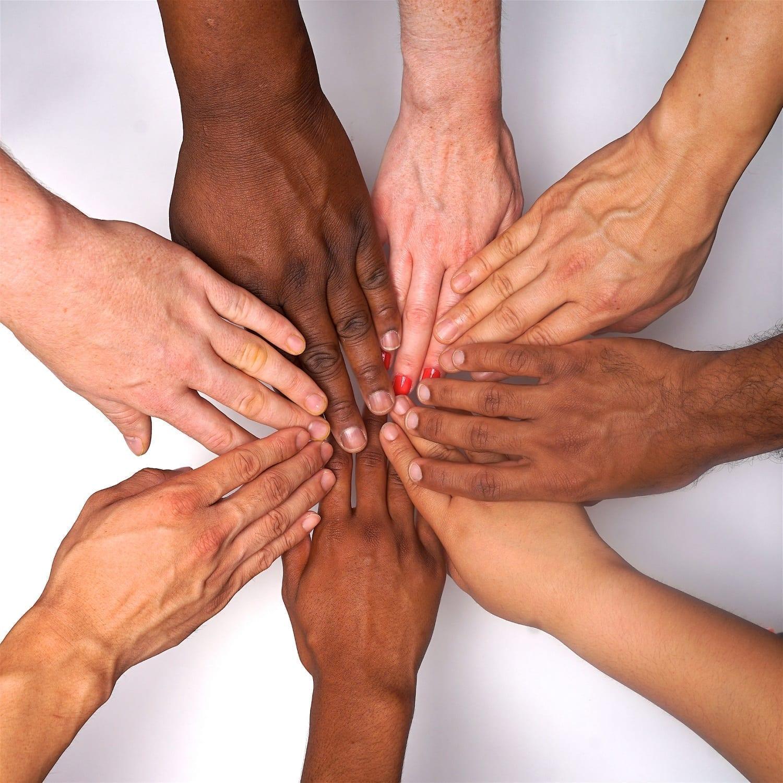 Women's hands of various skin tones forming a circle: ID 135073850 © tina gutierrez | Dreamstime.com