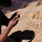 Man holding rock, photo credit: Canyon Ministries