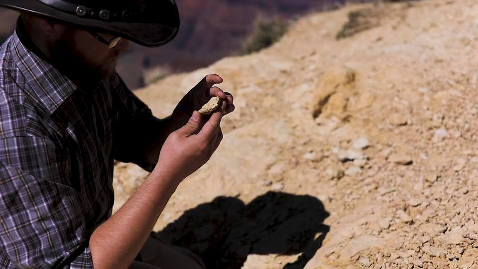 Man holding rock, photo credit: Canyon Ministries