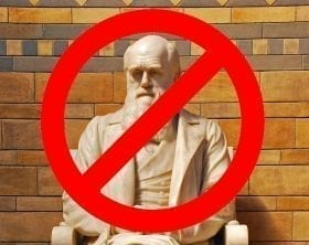 Darwin Statue with a Not Allowed Circle over him