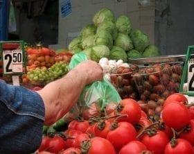 Choosing produce at a market