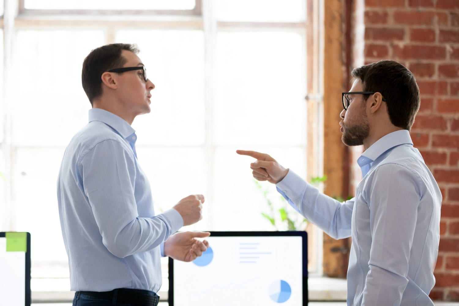 Man pointing his finger at the other guy: ID 130966660 © Fizkes | Dreamstime.com