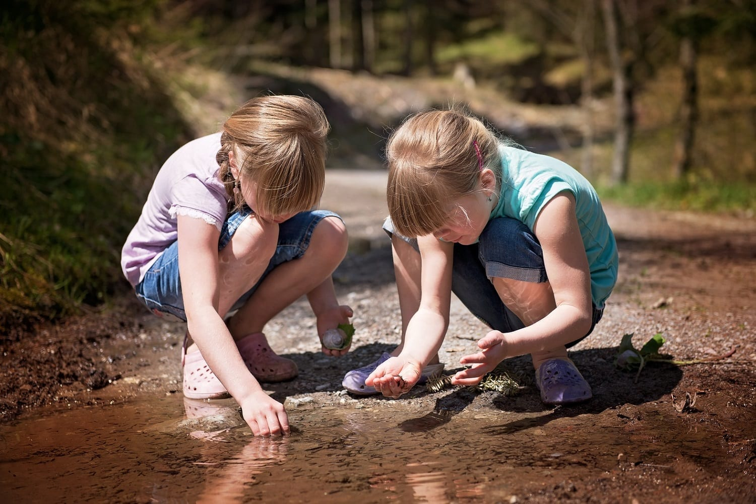 Girls playing in a mud bottomed puddle, photo credit: Pxhere