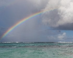 Rainbow with dark clouds over the ocean: ID 113478365 © Hopsalka | Dreamstime.com