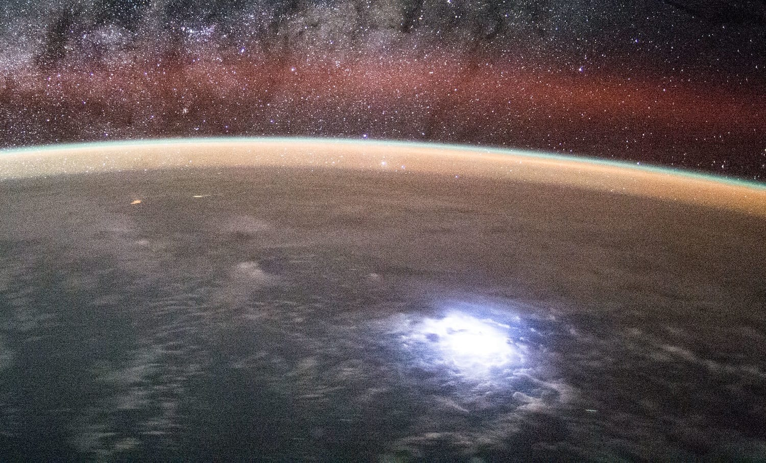 ISS Lightning, Earth's Horizon, and the Milky Way, photo credit: NASA
