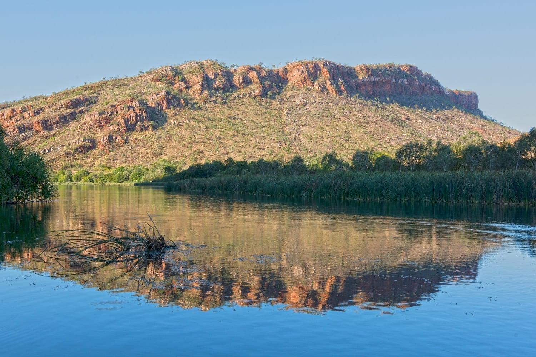 View of a sandstone hill from the Ord river near Kununurra, Western Australia.ID 108417732 © Johncarnemolla | Dreamstime.com