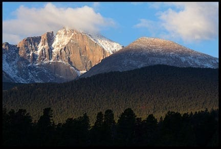 Mountain at dawn with clouds caught around the peak, photo credit: Pat Mingarelli
