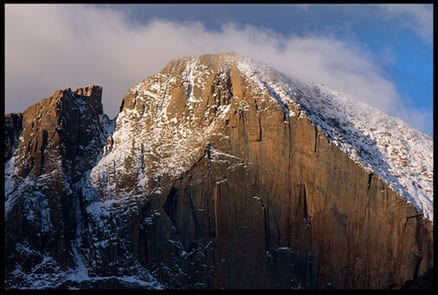 Mountain cliff face lit by morning light, photo credit: Pat Mingarelli