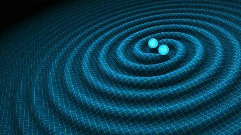 artist's grid showing gravitational waves around two circling stars, photo credit: NASA