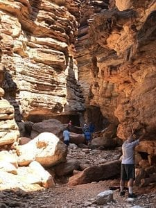 Closeup of Blacktail Canyon with visitors touching the walls, photo credit: Canyon Ministries