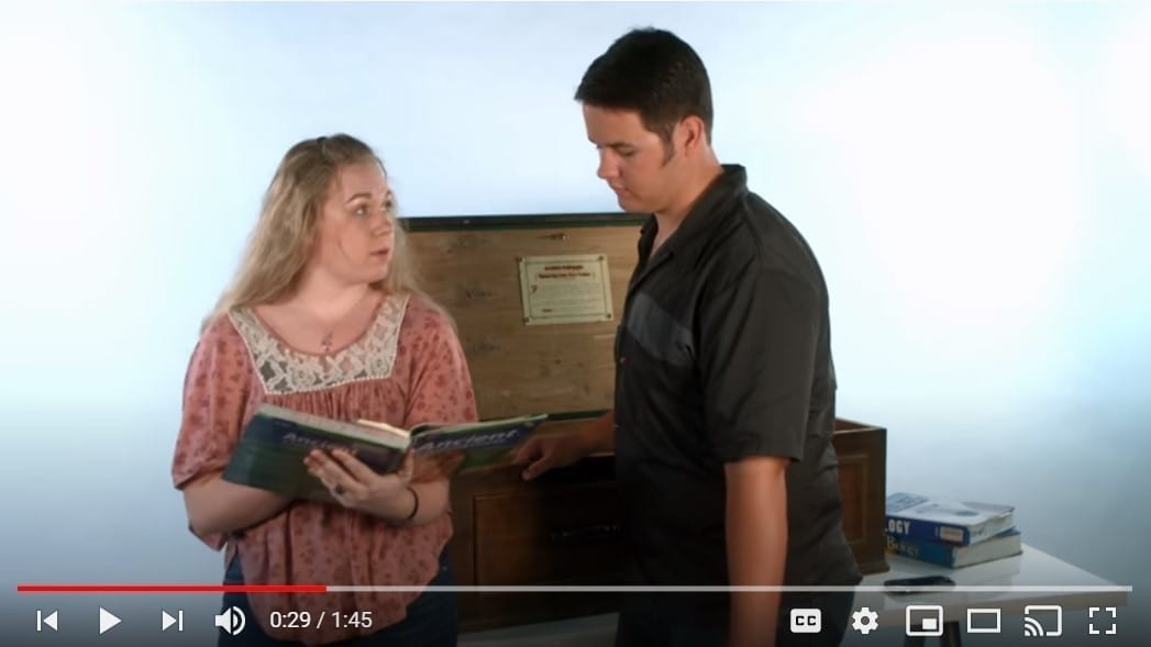 Two high schoolers examining a history textbook, YouTube still