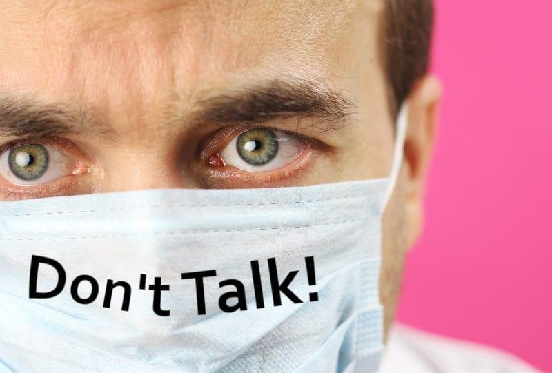 "Masked scientist with ""Don't Talk"": ID 175366208 © Denis Trofimov | Dreamstime.com"