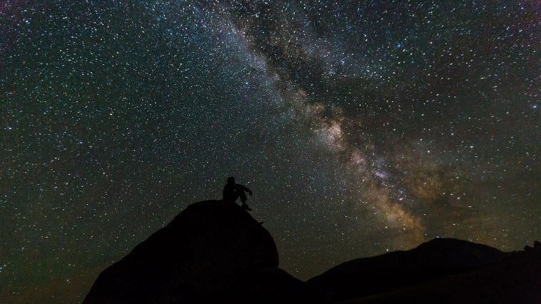 Silhouette of man gazing at the Milky Way, photo credit: Pixabay