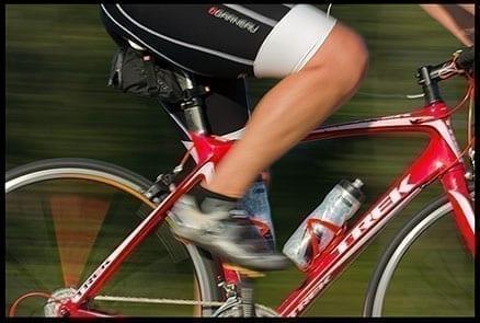 Blurred shot of a biker's leg and frame