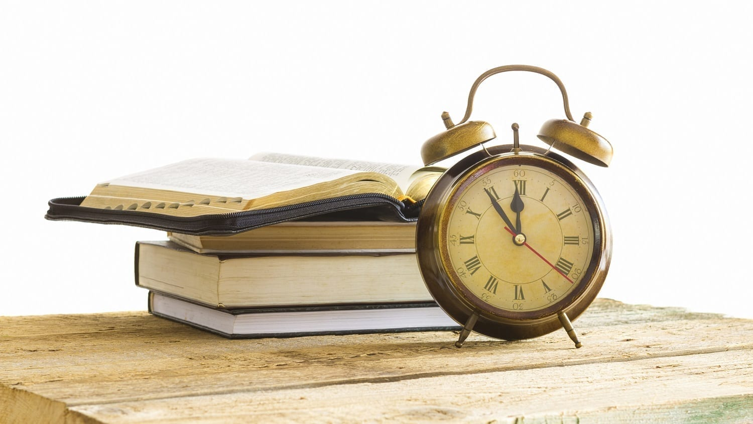 Bible on pile of books with alarm clock: ID 41050886 © Manaemedia | Dreamstime.com
