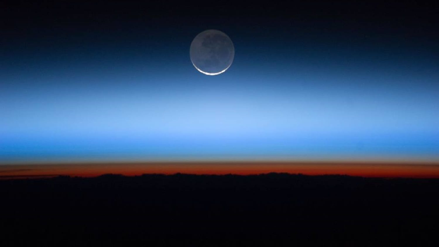 Earth's atmospheric layers at sunset from the ISS, photo credit: NASA