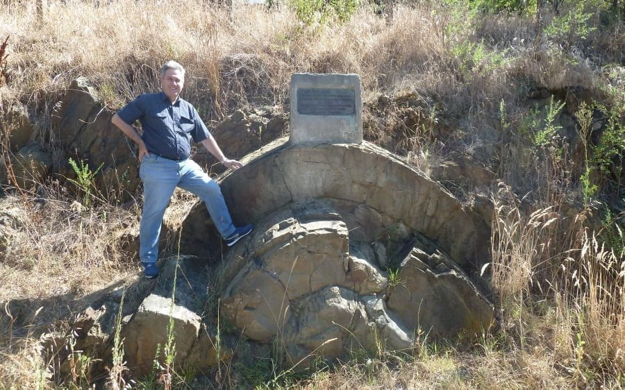 Tas Walker standing next to the anticline the article discusses