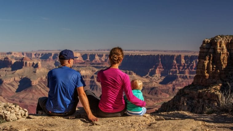 Family facing the Grand Canyon: Photo 111806279 © Anna Dudko   Dreamstime.com