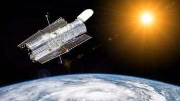 Hubble telescope above earth, composited by: Photo 62060786 © Photojogtom | Dreamstime.com