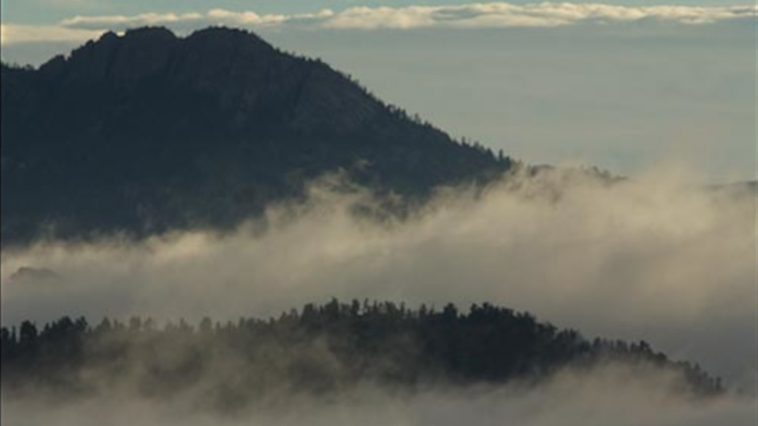 Wooded mountain in the sun with misty valleys, photo credit: Pat Mingarelli