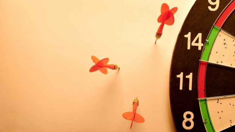 Darts in the wall instead of the target: Photo 30427503 / Missed Target Arrows © Sergii Gnatiuk | Dreamstime.com