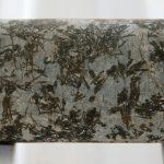 Komatiite rock core with visible dark crystals: Photo 131480592 © Adwo | Dreamstime.com